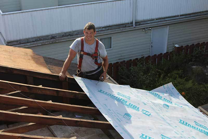 Vancouver roofer working on home roof