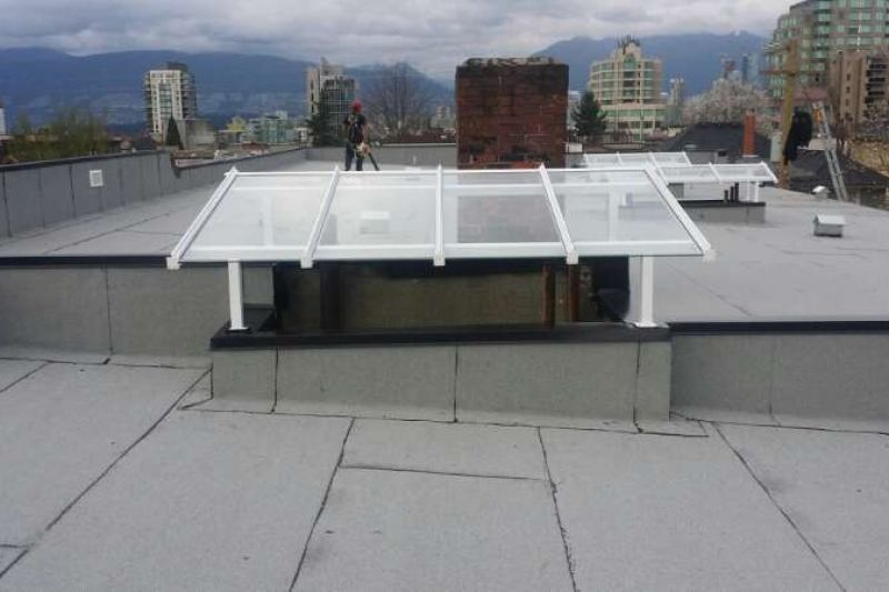 Roofer on flat roof