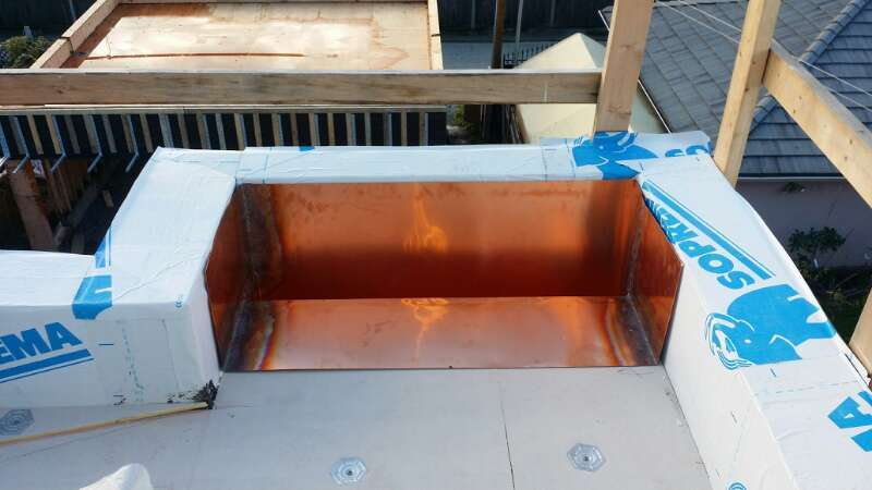 copper drain on flat roof