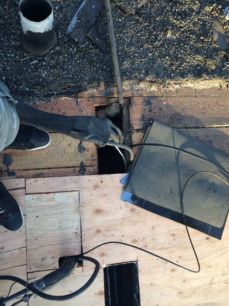 sealing flat roof wiring and vents