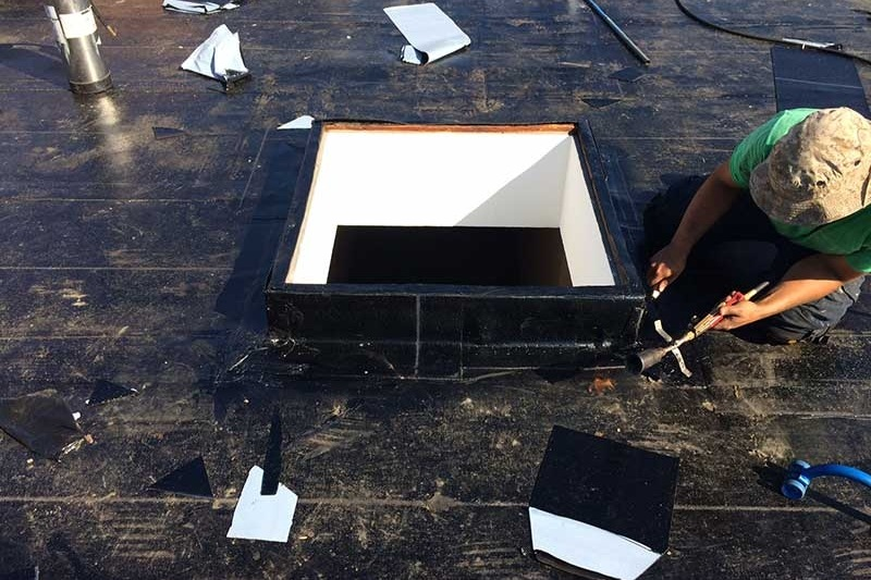 flat roof skylight well sealing waterproofing