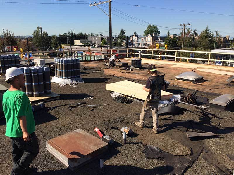 flat asphalt roof strip and replace