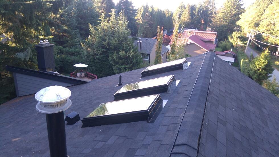 new ashpalt shingle roof with skylights