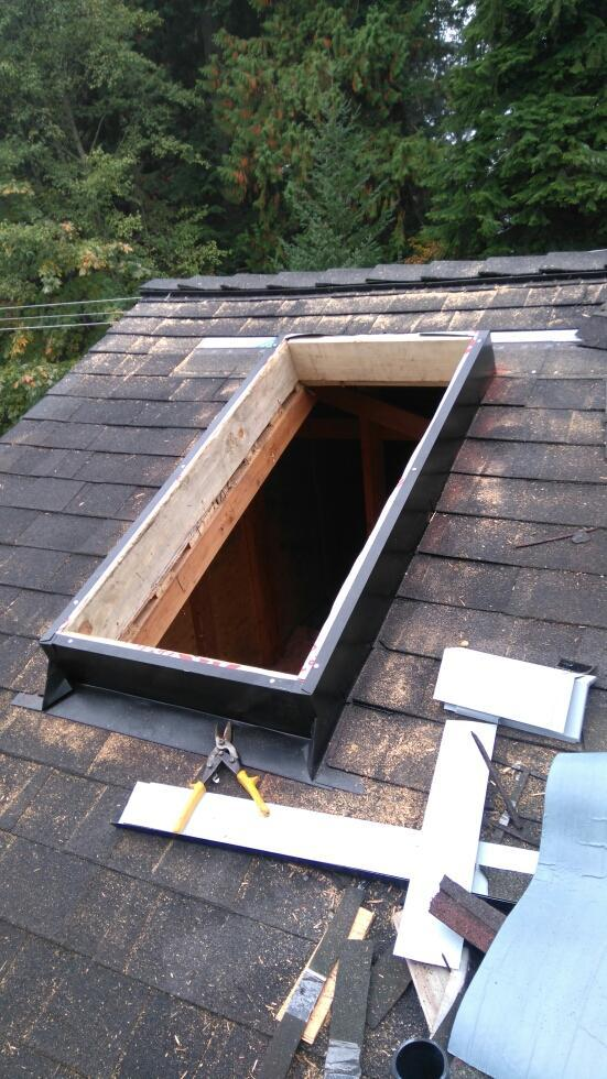new shingle roof skylight
