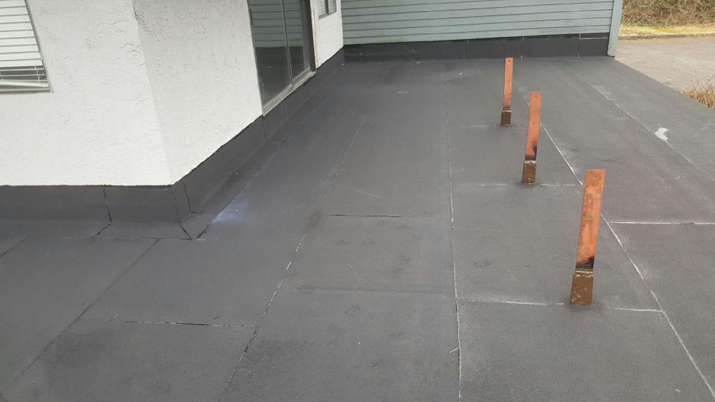 Waterproofing flat roof in Vancouver