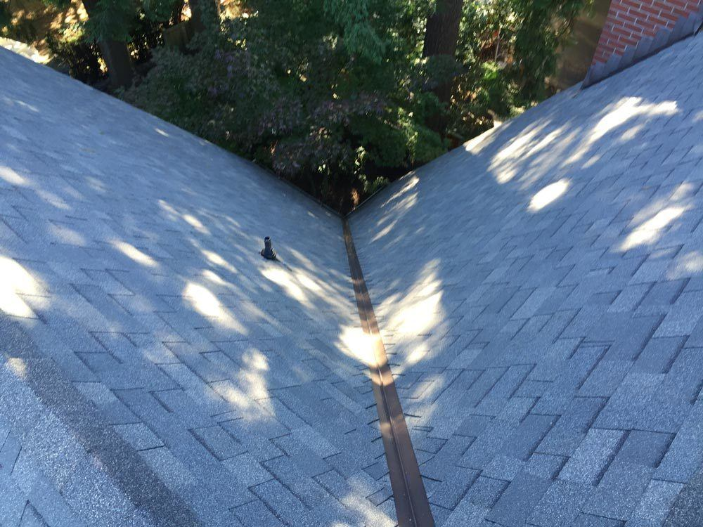 steep asphal reroofing