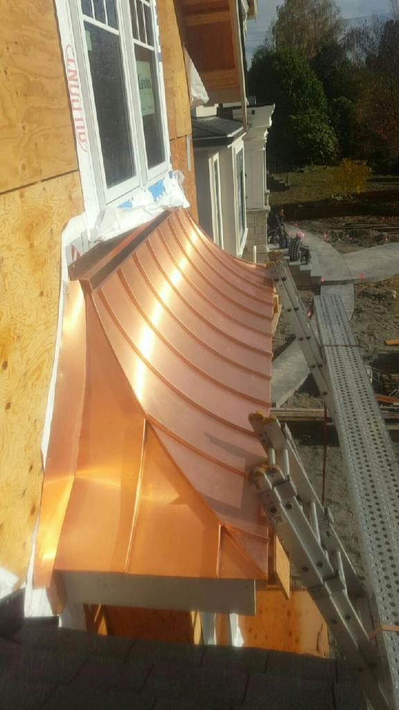 Copper cladding above windows