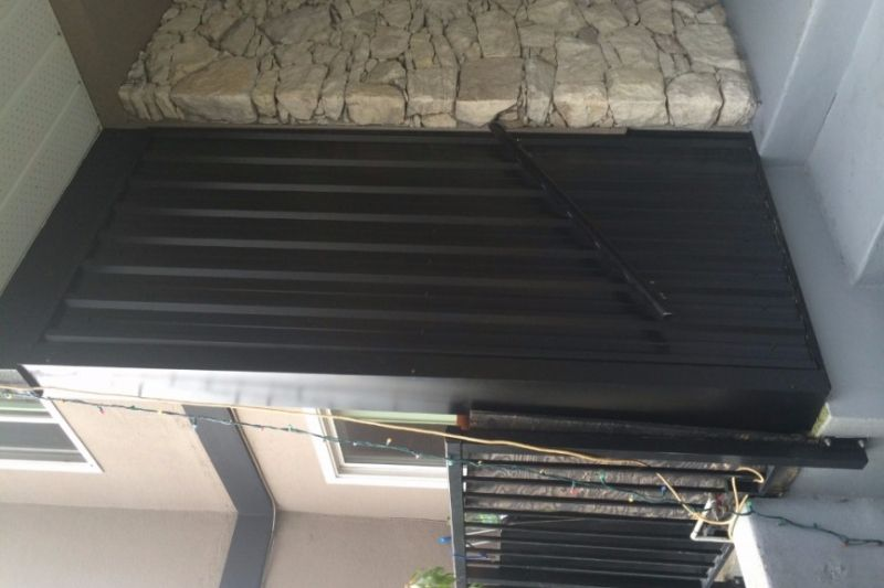 Metal sheet clad wall