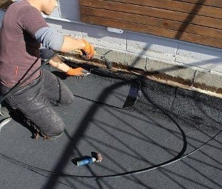 Torch on roofing repair for commercial or residential property